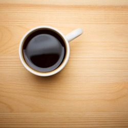 Cup of Coffee on Wooden Tabletop, Top View