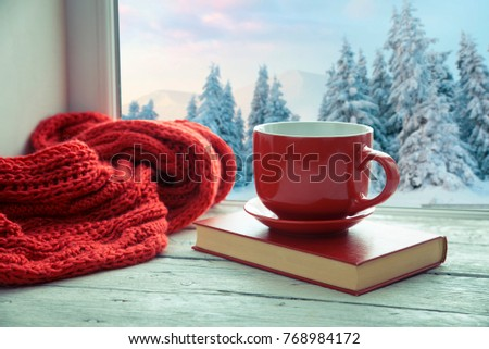 Cup of coffee or tea, smartphone and earbuds with autumn leaves near a window. Autumn playlist concept. Autumn music for rainy days. #768984172