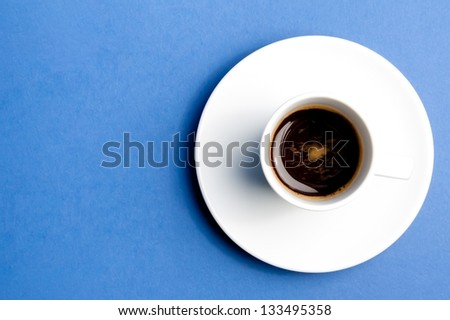 cup of coffee over the blue background