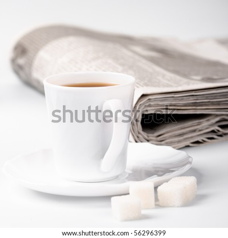 cup of coffee, sugar and stack of newspapers closeup