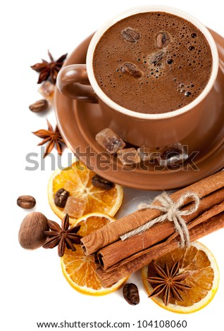 Cup of coffee, sweets and spices