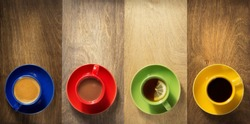 cup of coffee, tea and cacao at wooden background