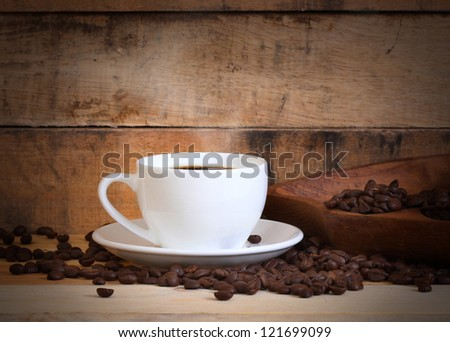 cup of coffee white cup on wooden background