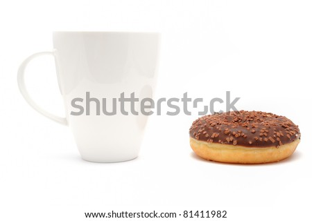 Cup of coffee with a chocolate donut 	Cup of coffee with a chocolate donut