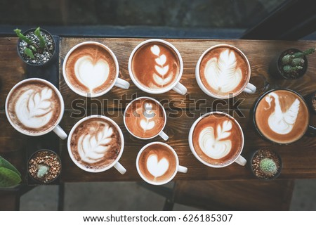 Cup of coffee with a lot of beautiful latte art. #626185307