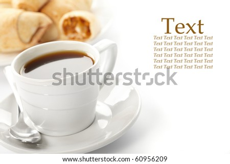 Cup of coffee with a roll