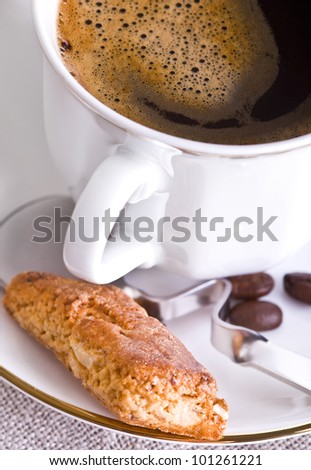 Cup of coffee with almond cookies