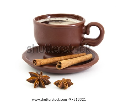 Cup of coffee with anise star and cinnamon on the white background