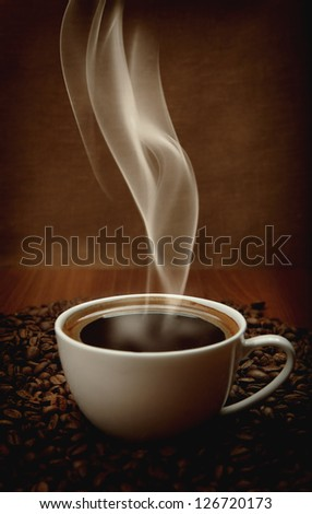 cup of coffee with aromatic smoke