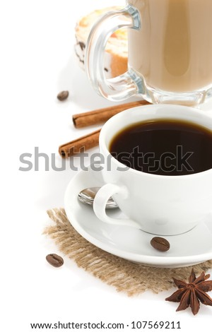 cup of coffee with beans and sweets isolated on white background
