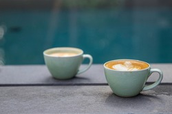 Cup of coffee with beautiful latte art on wooden table.. relaxation concept