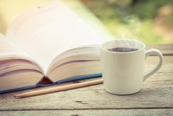 Cup of coffee with books on the table.