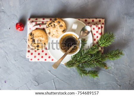 Cup of coffee with chocolate cookies and Christmas decoration on grey concrete background with copy space #754689157