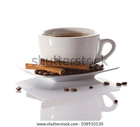 cup of coffee with cinnamon sticks  isolated on white