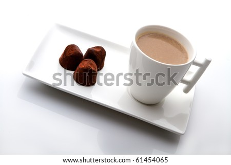 cup of coffee with cocoa candy on white background.