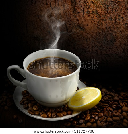 Cup of coffee with coffee beans on a brown background