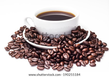 Photo of cup of coffee with coffee beans over white background