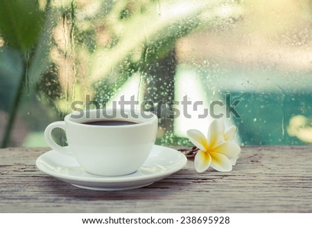 Cup of coffee with flower in the morning.