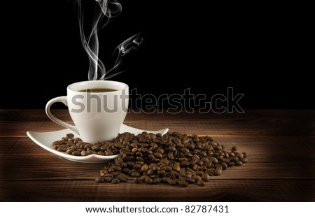 cup of coffee with grains on a black background