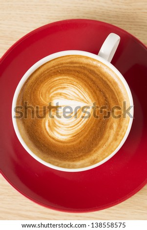 Cup of coffee with heart illustration from foam