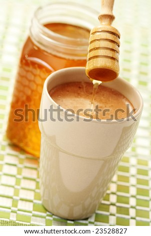 cup of coffee with honey - food and drink