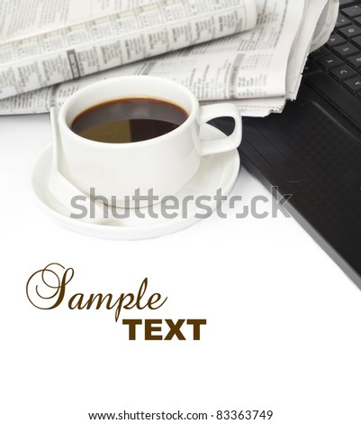 cup of coffee with laptop and newspaper