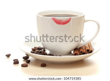 cup of coffee with lipstick mark beans and cinnamon sticks isolated on white