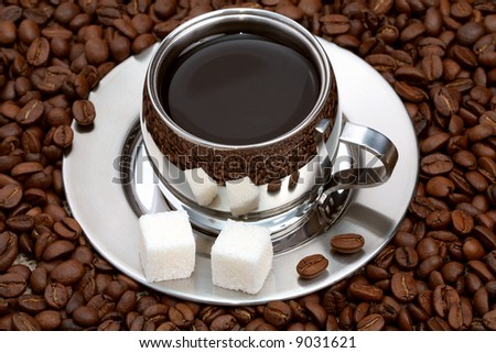 Cup of coffee with lump sugar and beans, coffee series - stock photo