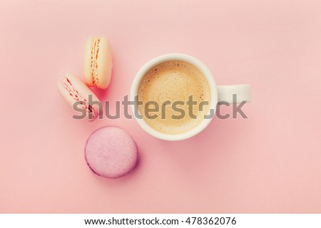 cup of coffee with macaron on...