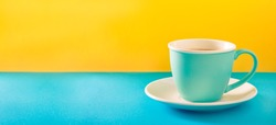 Cup of coffee with milk in a cup on colorful background