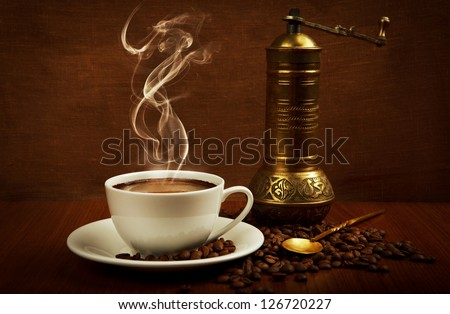 cup of coffee with oriental mill