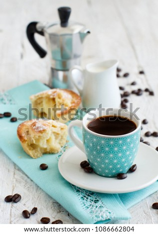 Cup of coffee with pasticciotto pastry on a rustic background close up #1086662804