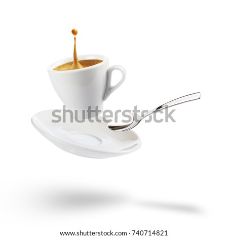 cup of coffee with saucer and spoon floating on white background with shadow