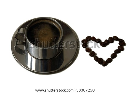 Cup of coffee with seed and heart from it, isolated on white