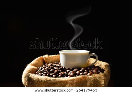 Cup of coffee with smoke and coffee beans in burlap sack, This photo is available without smoke