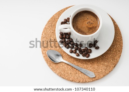 Cup of Coffee with Spoon and Few Beans