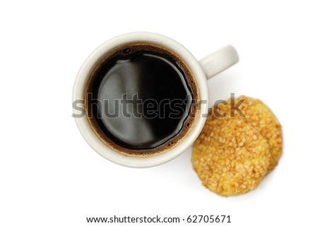 Cup of delicious coffee and sesame biscuits isolated on white background