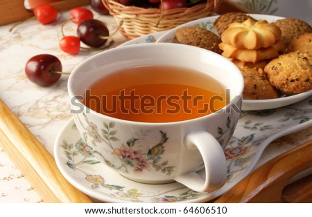 Cup of English tea with biscuits