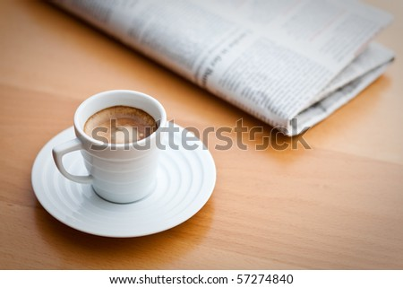 cup of Espresso and newspaper