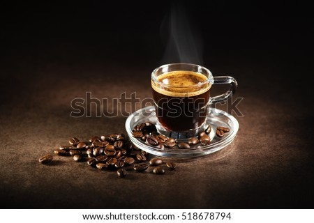 Cup of espresso coffee on dark background. #518678794