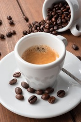 Cup of espresso coffee on wood background