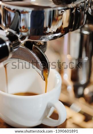 Cup of Espresso coffee with espresso machine #1390601891