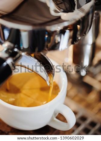 Cup of Espresso coffee with espresso machine #1390602029