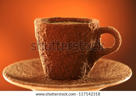 Cup of espresso covered with cocoa powder