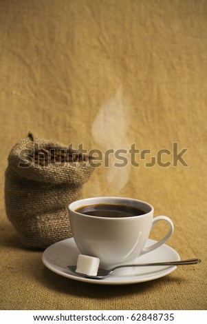cup of fragrant, hot coffee on a textile background