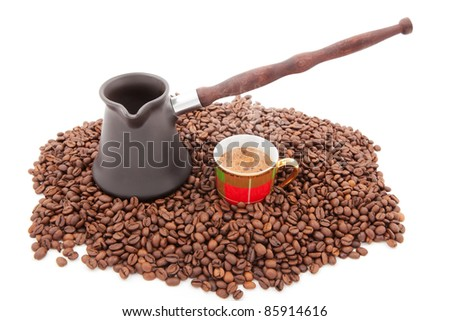 Cup of fresh coffee against coffee grains