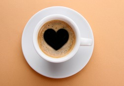 Cup of fresh coffee with heart sign