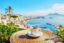 Cup of fresh espresso coffee in a cafe with view on Vesuvius mount in Naples, Campania, Southern Italy