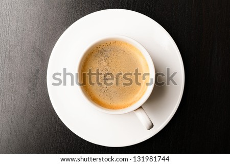 cup of fresh espresso on table view from above