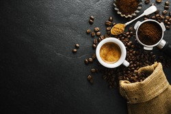 Cup of fresh made coffee served in cup on dark background. Coffee background. Closeup.